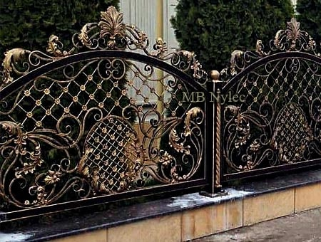 A heavily decorated forged fence