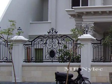 An elegant forged fence wrought iron