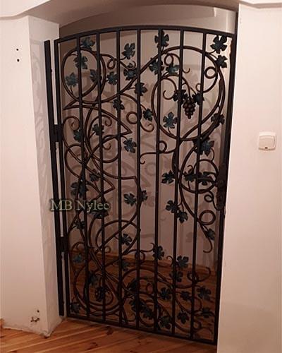 Door grille with grapes - door to winery