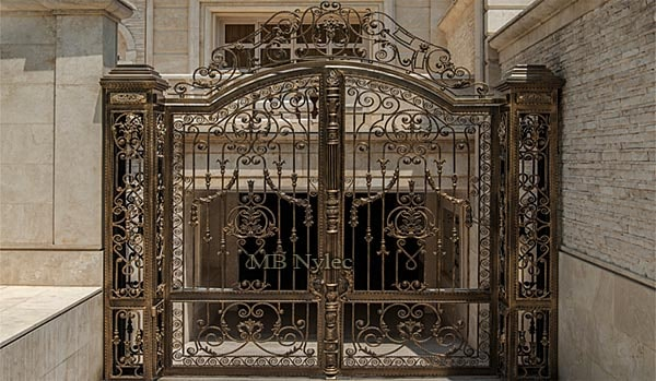 Elegant gate with forged columns