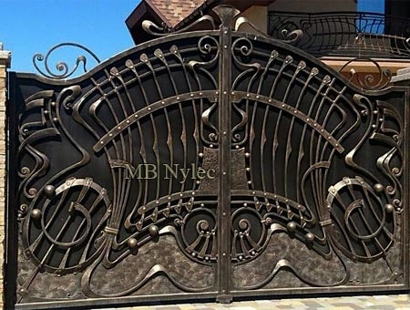 Forged gate with elements of Art Nouveau
