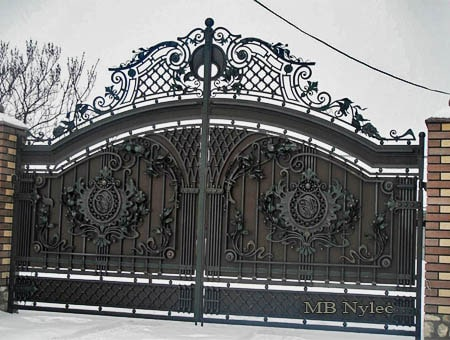 Forged gate with steel infill