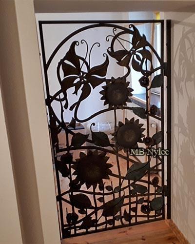 Openwork forged decorative door grille