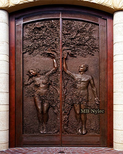 The door to the church is carved out of bronze - Adam and Eve