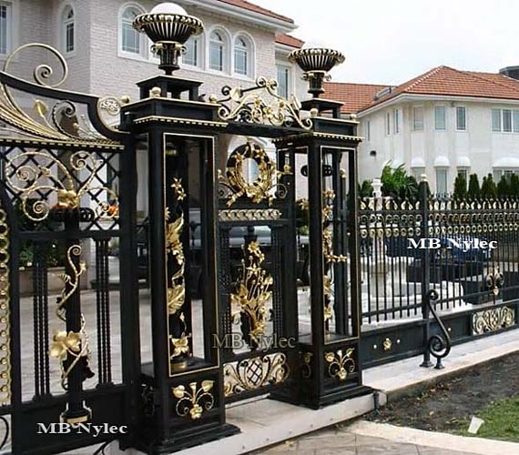 Unique openwork forged pillars for the gate wicket fence