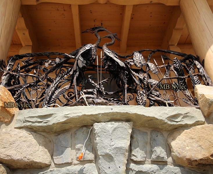 Forged balustrade with herons