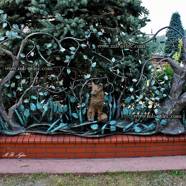 Forged fence span with a fox scene