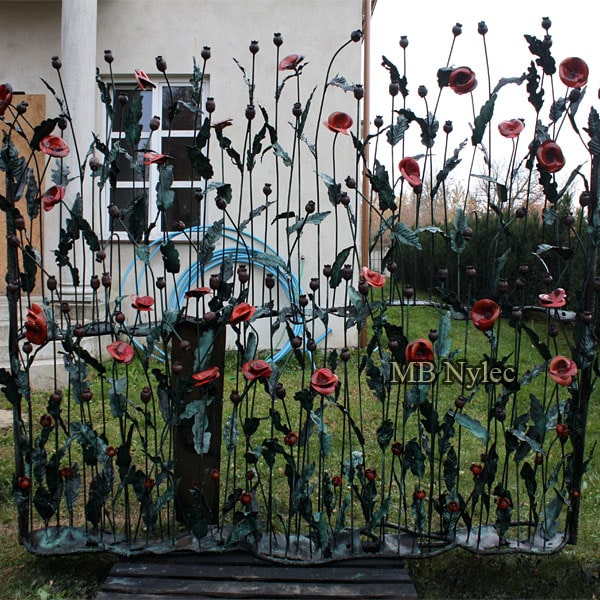 Forged fence span with poppies