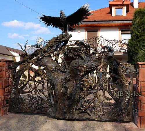Forged forest gate with an oak and eagle scene
