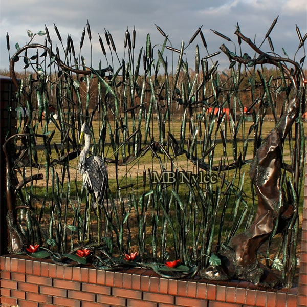 Forged heron in reeds - forged fence