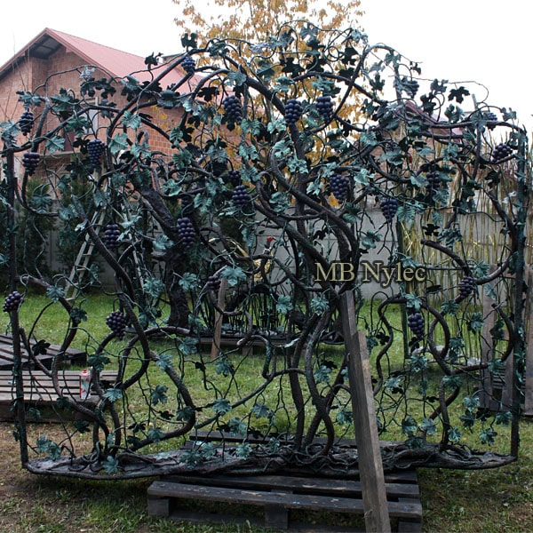 Forged steel fence with a grape scene