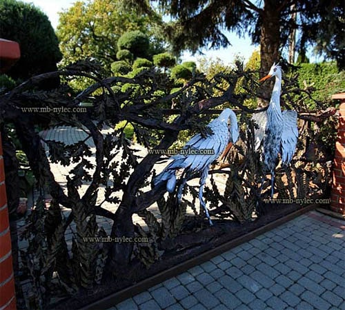 Wrought iron gate with herons scene