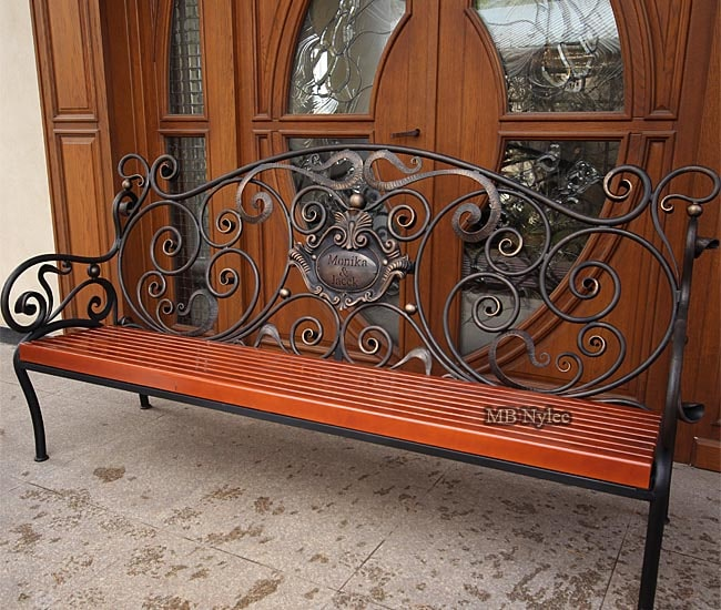 Forged garden bench with a coat of arms