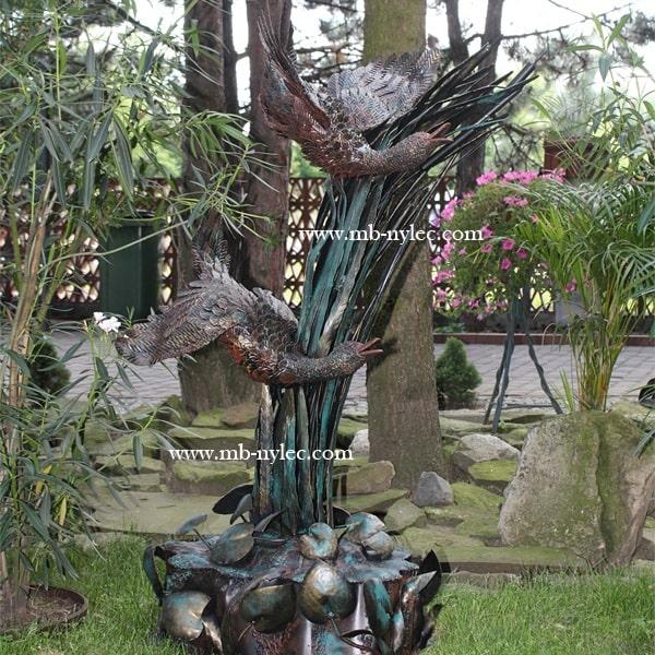 Geese on a pedestal - sculpture