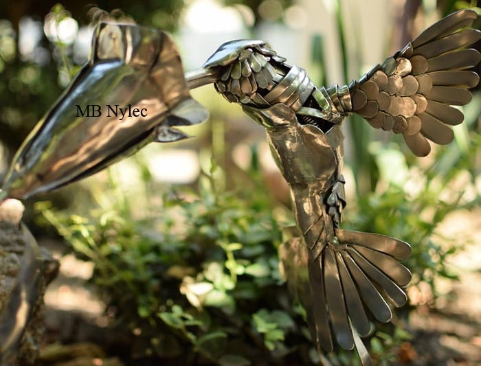 Hummingbird and flower figure in stainless steel