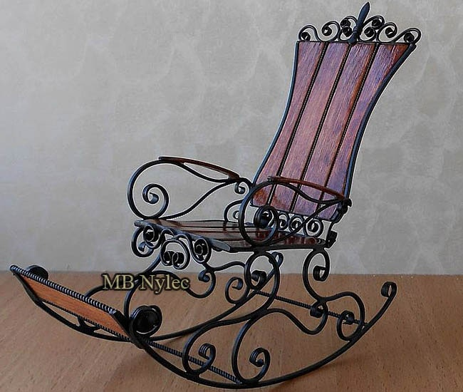 Forged rocking chair with footrest