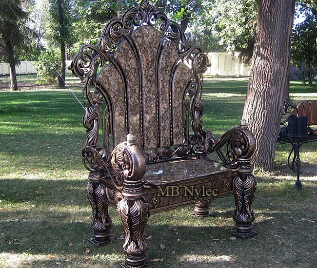 Forged throne - a huge armchair covered with granite