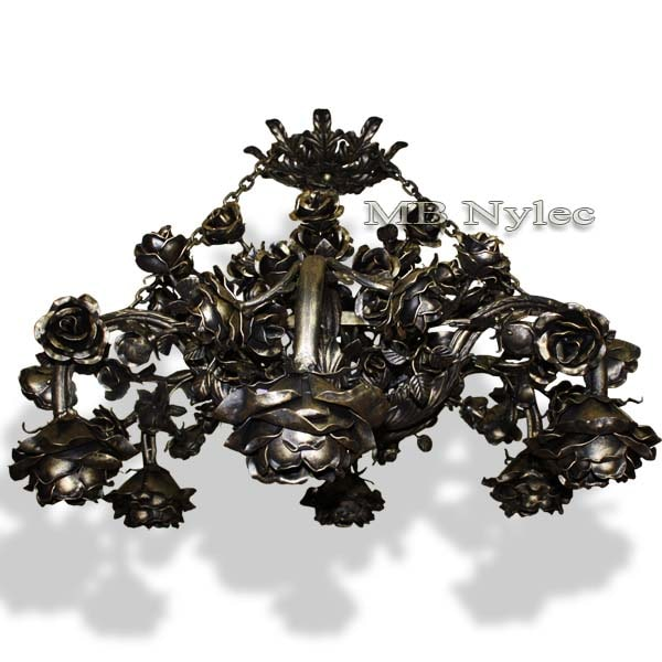 A forged chandelier in rose motifs