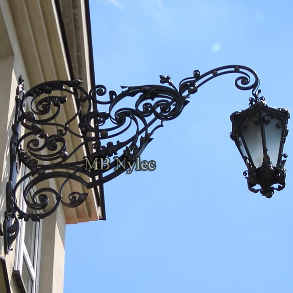 A huge forged wall lamp 2 meters length, 100 kg weight.