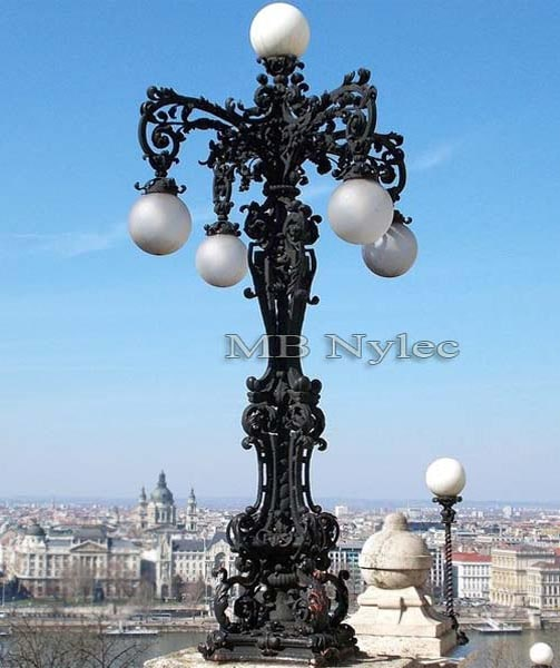 A massive baroque wrought iron lantern