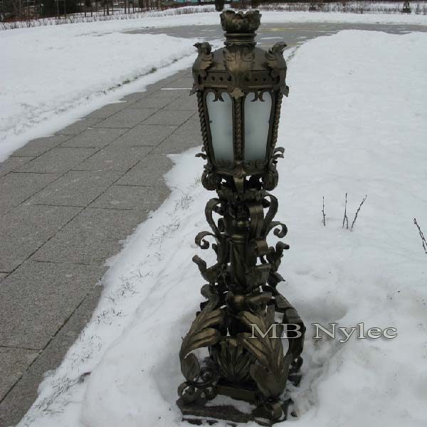 A richly decorated wrought lamp
