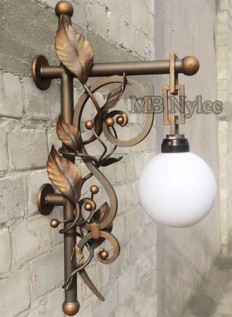An elegant forged wall lamp wrought