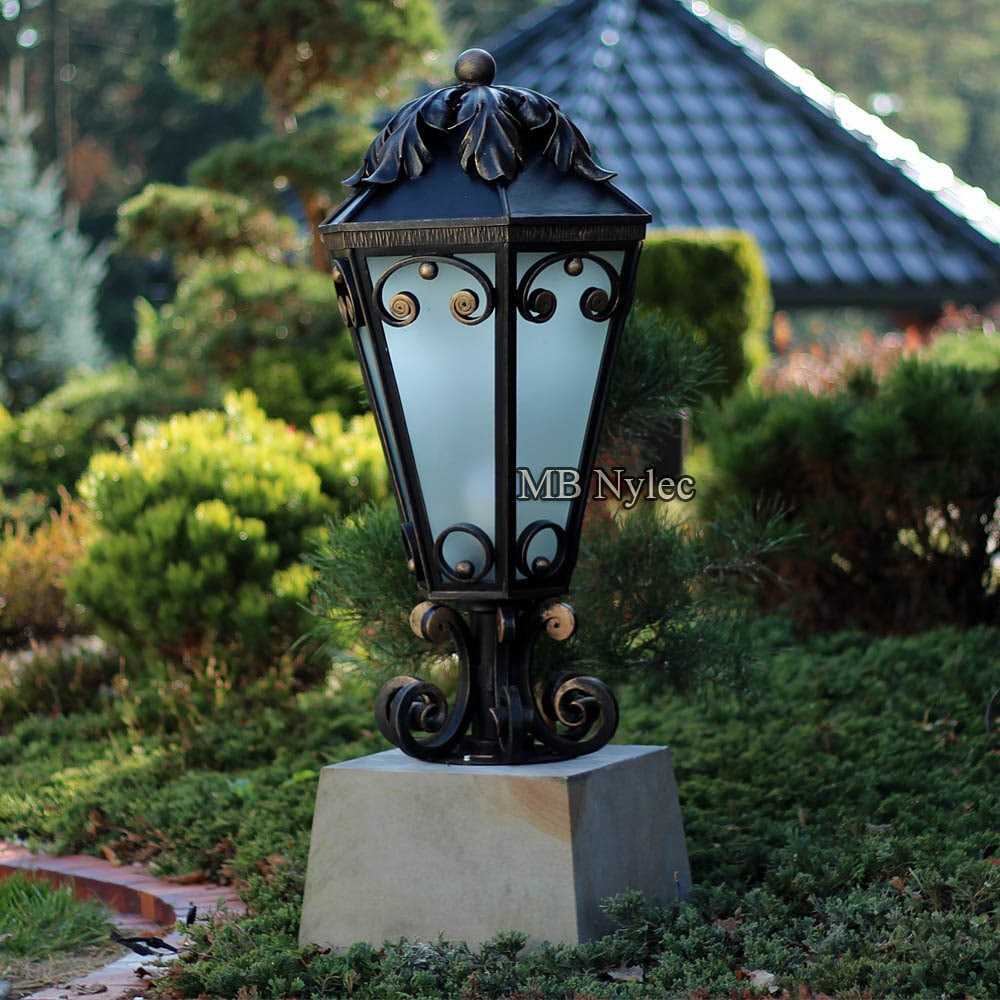 Elegant wrought lamp in the style of glamor