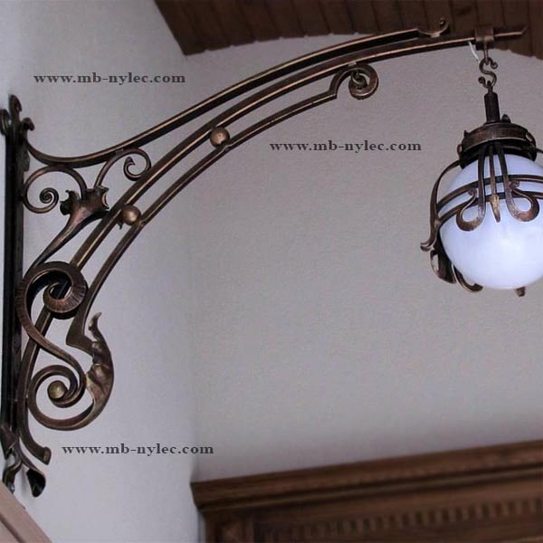 Forged wall lamp with a long arm