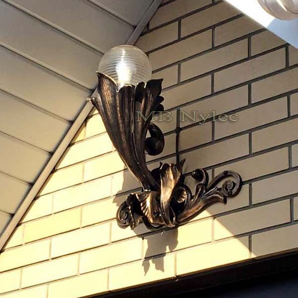 Handmade forged acanthus style wall lamp