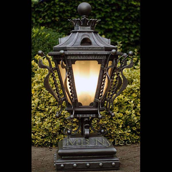 Richly decorated massive wrought lamp