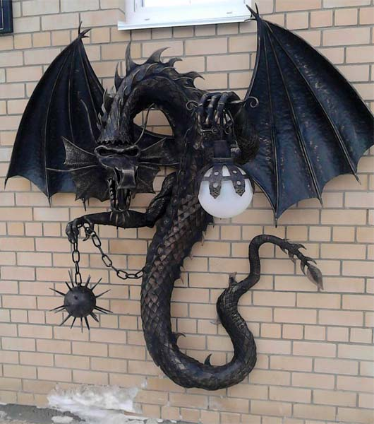 Wall wrought iron lamp with a handmade dragon