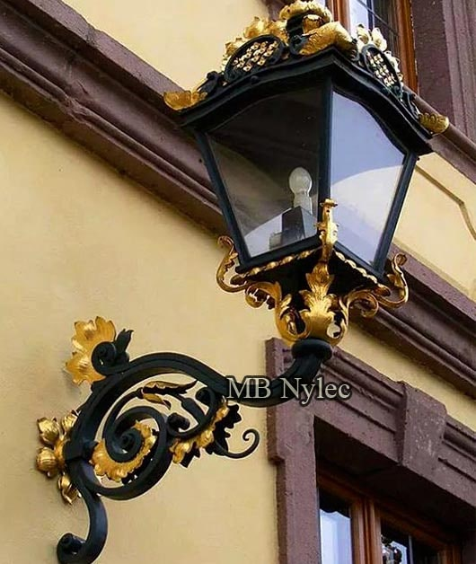 Wrought iron wall lamp for a mansion residence