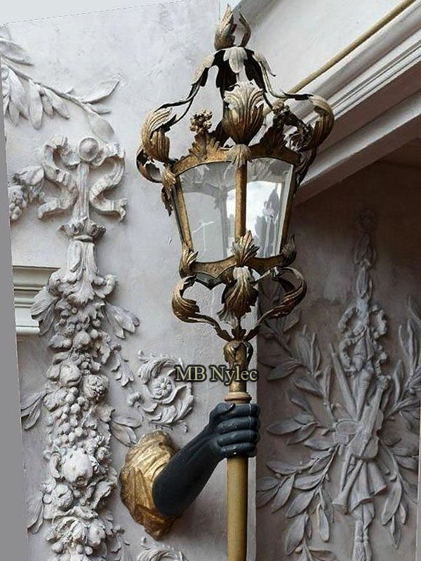 Wrought wall lamp with hand - steel sculpture