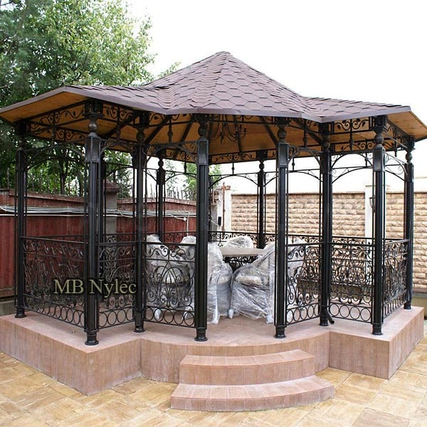 An elegant forged gazebo with a traditional roof