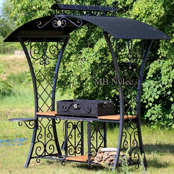 An elegant forged grill with a roof