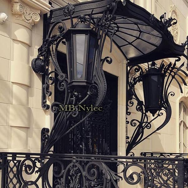 An exclusive massive forged canopy with lamps - Art Nouveau