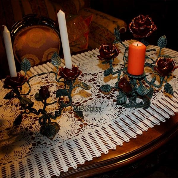 Forged candlestick with roses