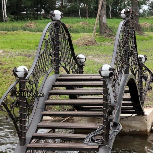 Forged garden bridge with lamps